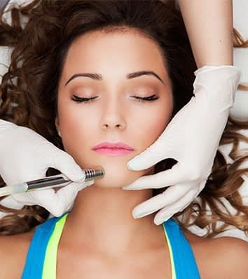 Women under going a skin care treatment service in Fort Collins, CO - GLO Skin Spa
